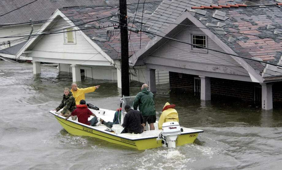 St. Berard Parish deputy sheriff Jerry Reyes uses his boat to rescue residents. Photo: ERIC GAY, AP / AP