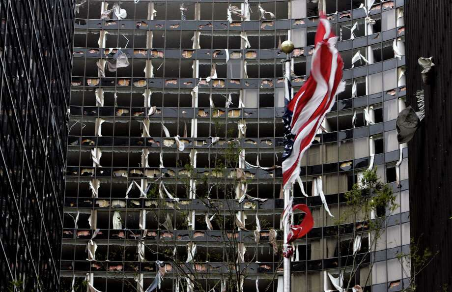 A tattered American flag flies in front of the blown out Hyatt Hotel in New Orleans. Photo: BILL HABER, AP / AP