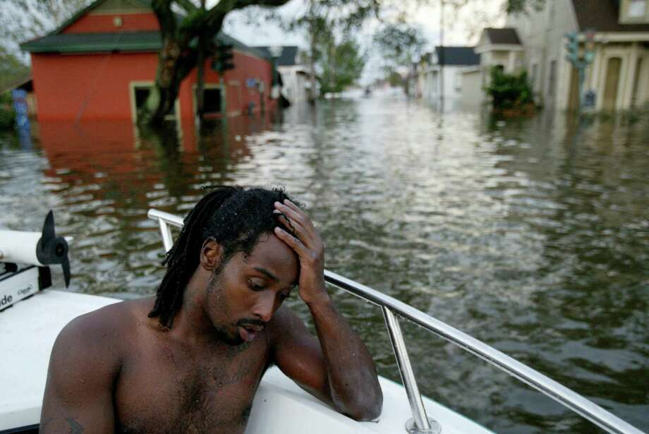Henry Rhodes sits in a New Orleans Police Department boat after being rescued in the 7th Ward of the city. Photo: GARY CORONADO, AP / THE PALM BEACH POST