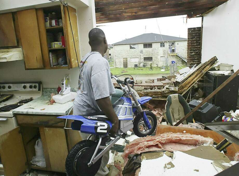 Leonard T. Harris, Sr. retrieves a scooter from the wreckage of his apartment after hurricane Katrina struck Gretna, La. Photo: RICK WILKING, REUTERS / X00301