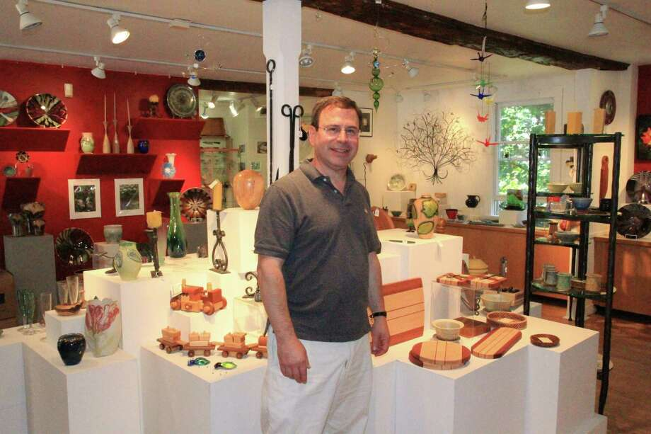 Howard Lasser, executive director of the Brookfield Craft Center,stands among artistic creations that are part of the center's faculty show. Photo: Contributed Photo