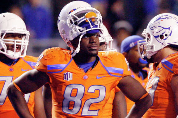 In this Nov. 2012, photo, then-Boise State NCAA college football player Samuel Ukwuachu (82) watches from the sidelines during an official review of a San Diego State touchdown at Bronco Stadium in Boise, Id. A one-time All-American who transferred to play football at Baylor University has been convicted of sexually assaulting a fellow student athlete in 2013. A jury in Texas district court found 22-year-old Sam Ukwuachu guilty Thursday, Aug. 20, 2015, of one count of sexual assault. ( Joe Jaszewski/Idaho Statesman via AP)  LOCAL TELEVISION OUT (KTVB 7); MANDATORY CREDIT