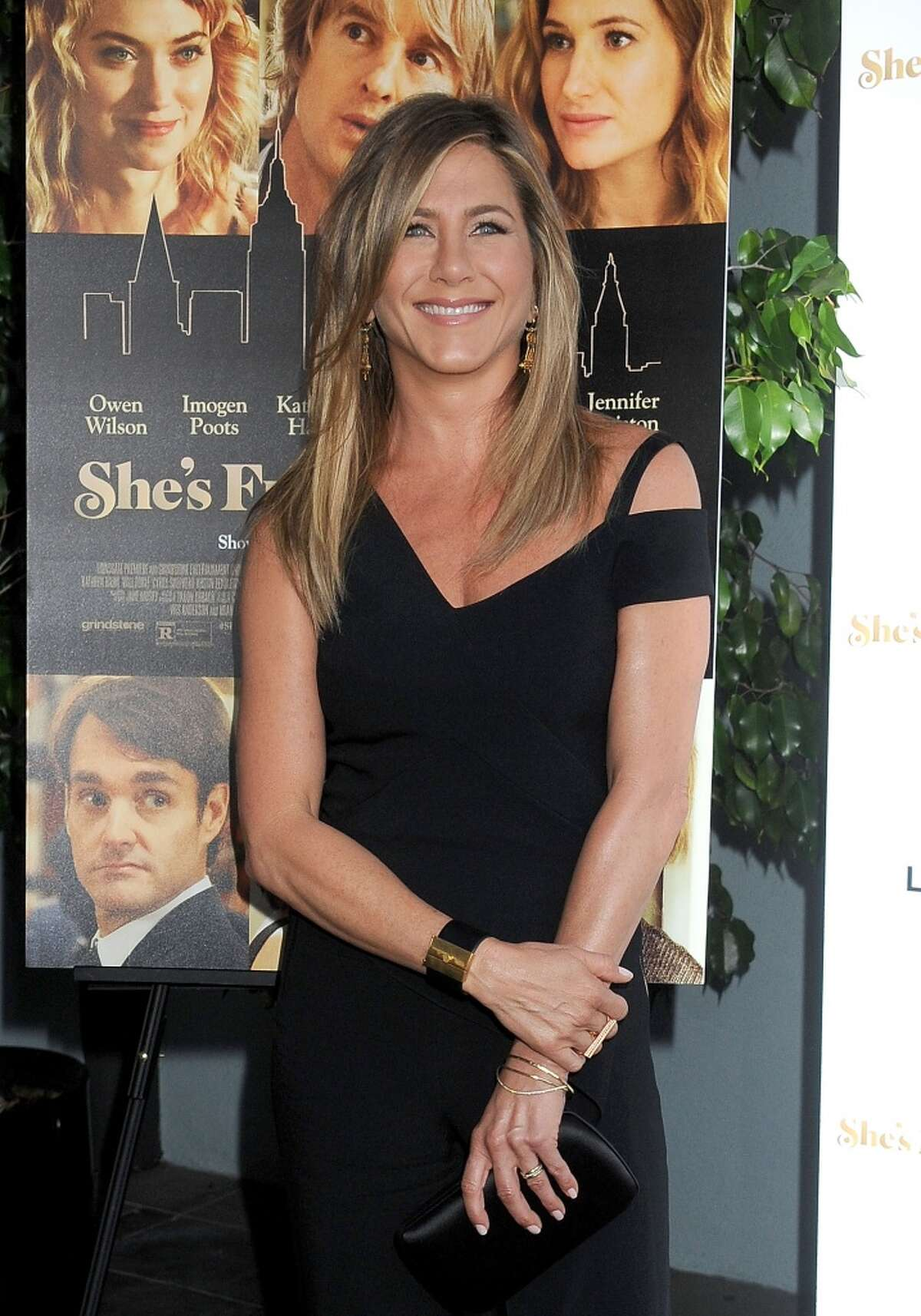 """Actress Jennifer Aniston arrives at the Los Angeles Premiere """"She's Funny That Way"""" at Harmony Gold on August 19, 2015 in Los Angeles, California."""