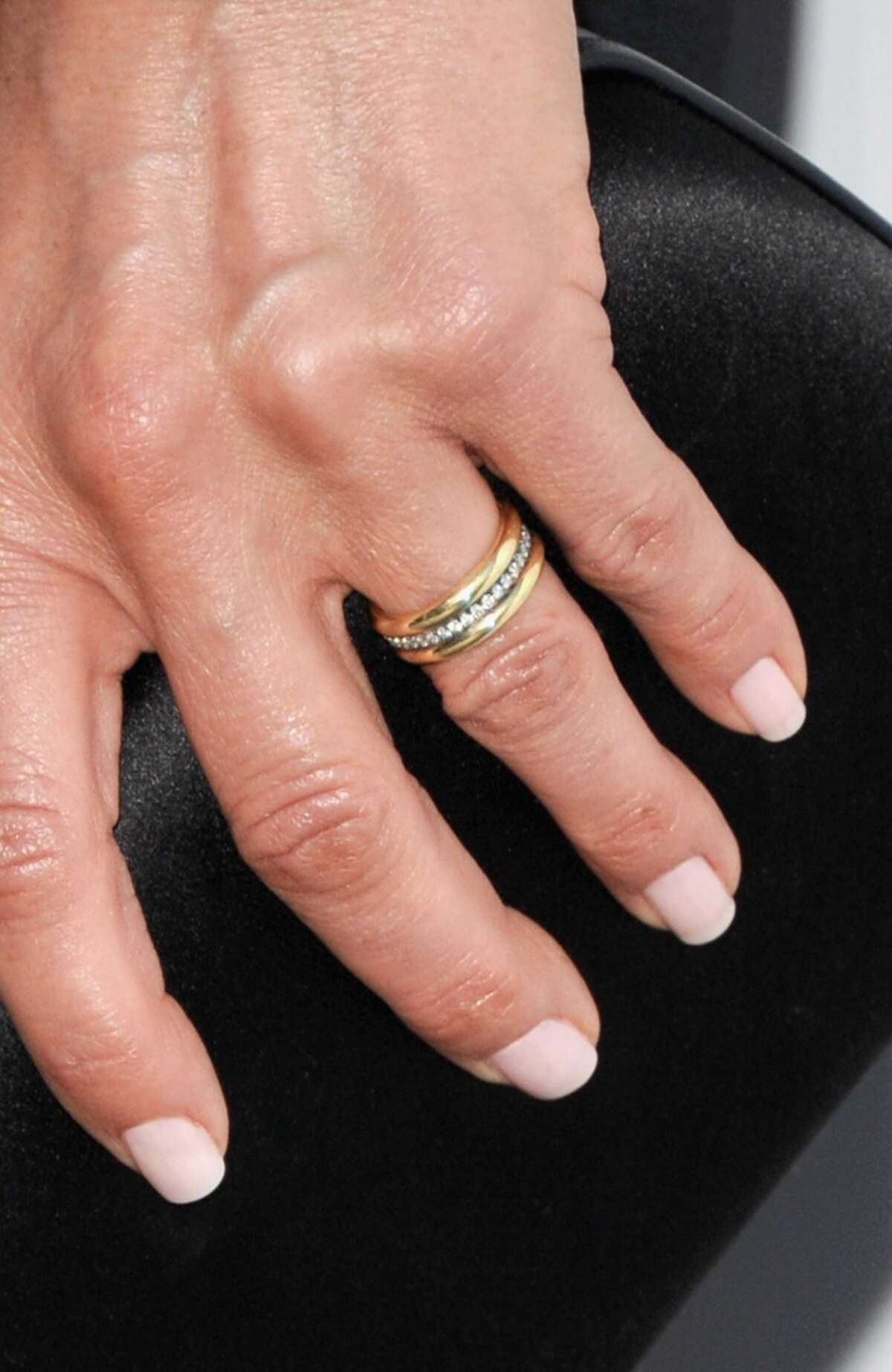 A close-up shot of Aniston's wedding band.