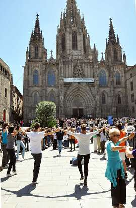 "In Barcelona, locals still join hands and dance the everyone's-welcome ""sardana"" in front of the cathedral almost every Sunday."