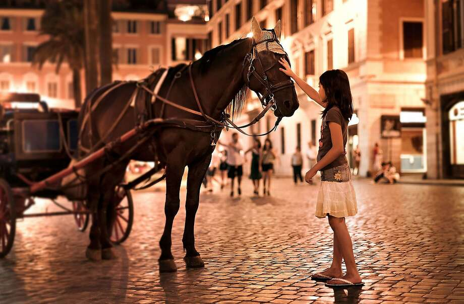 There's magic afoot when you sightsee at night in Rome, as this young girl discovers near the Spanish Steps.  az110708rm-1625.jpg Photo: Dominic Arizona Bonuccelli, Rick Steves' Europe