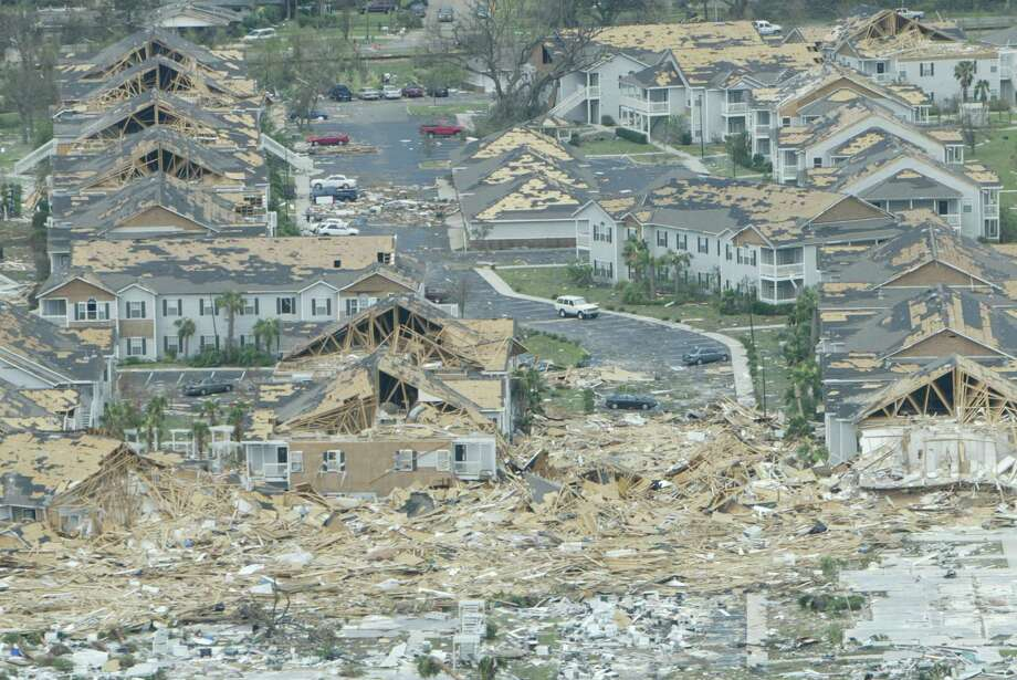 Several buildings are flattened and no structure is unscathed in this apartment complex outside Biloxi, Miss.  Along the state's coast, nearly every structure within a half-mile inland from the beach was destroyed. Photo: Kevin Fujii, Houston Chronicle / Houston Chronicle