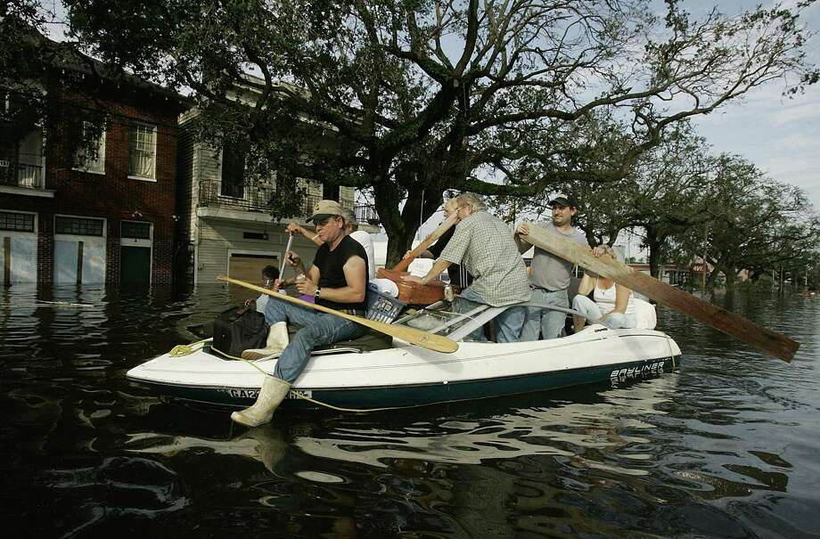 People use a boat to get to higher ground as water began to rise in New Orleans. Photo: Mark Wilson, Getty Images / Getty Images North America
