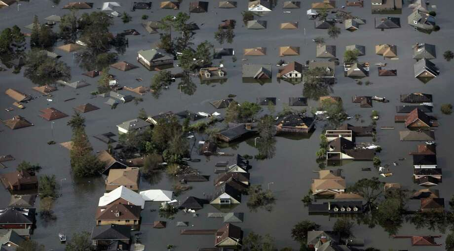 A neighborhood, flooded in the wake of Hurricane Katrina, is shown in an aerial view in New Orleans. Photo: SMILEY N. POOL, AP / THE DALLAS MORNING NEWS