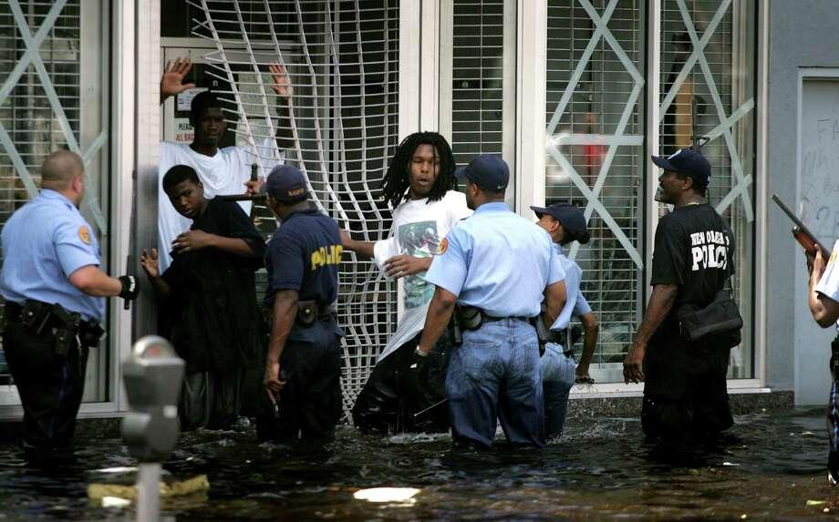 Police arrest alleged looters in New Orleans. Photo: KHAMPHA BOUAPHANH, KRT / FORT WORTH STAR-TELEGRAM