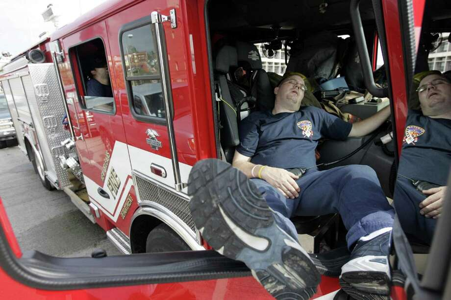 Firefighters rest in their truck in New Orleans. Photo: MICHAEL AINSWORTH, KRT / DALLAS MORNING NEWS
