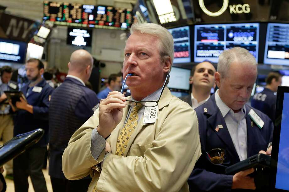 Trader Dermott Clancy watches Friday's chaos at the New York Stock Exchange, where investors had a rough week. Photo: Richard Drew, Associated Press