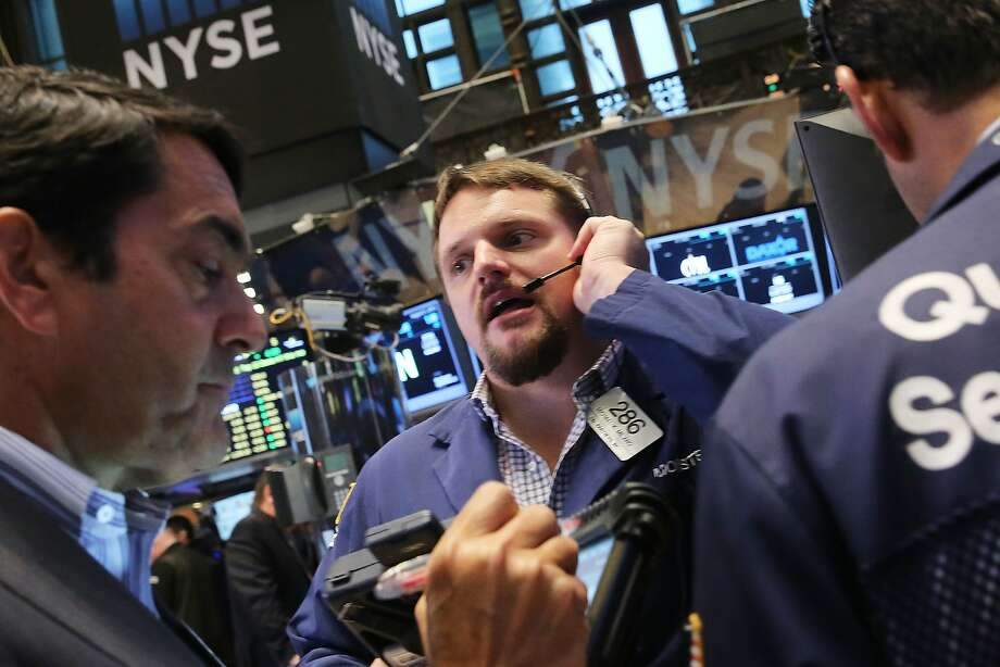 Traders had a rough day on the floor of the New York Stock Exchange. The Dow fell more than 500 points as global markets continue to react to economic events in China. Photo: Spencer Platt, Getty Images
