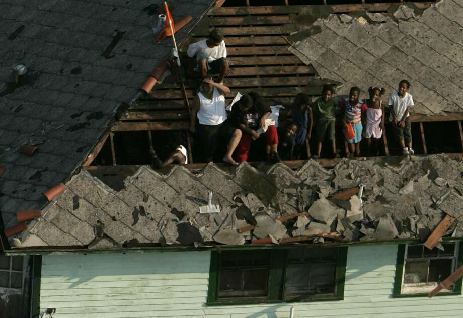 Residents wait on a rooftop to be evacuated in New Orleans. Photo: SMILEY N. POOL, AP / THE DALLAS MORNING NEWS