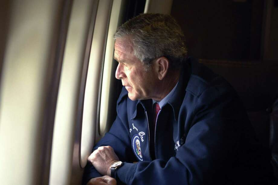 President George W. Bush, on Air Force One, surveys the damage along the Gulf Coast states of Louisiana, Mississippi and Alabama. Photo: MANNIE GARCIA, Reuters / X01502