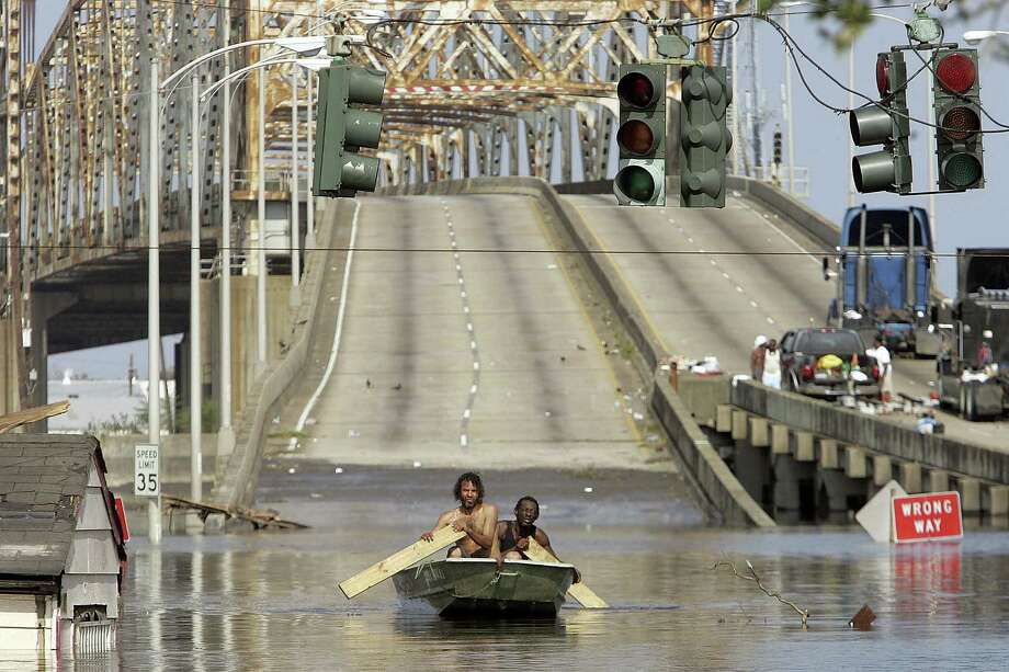 Two men paddle in high water after Hurricane Katrina devastated New Orleans. Photo: Getty Images / Getty Images North America