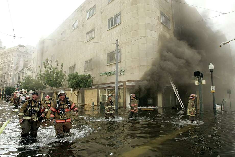 Firefighters arrive at a store on fire on Canal in New Orleans. Photo: Mark Wilson, Getty Images / Getty Images North America