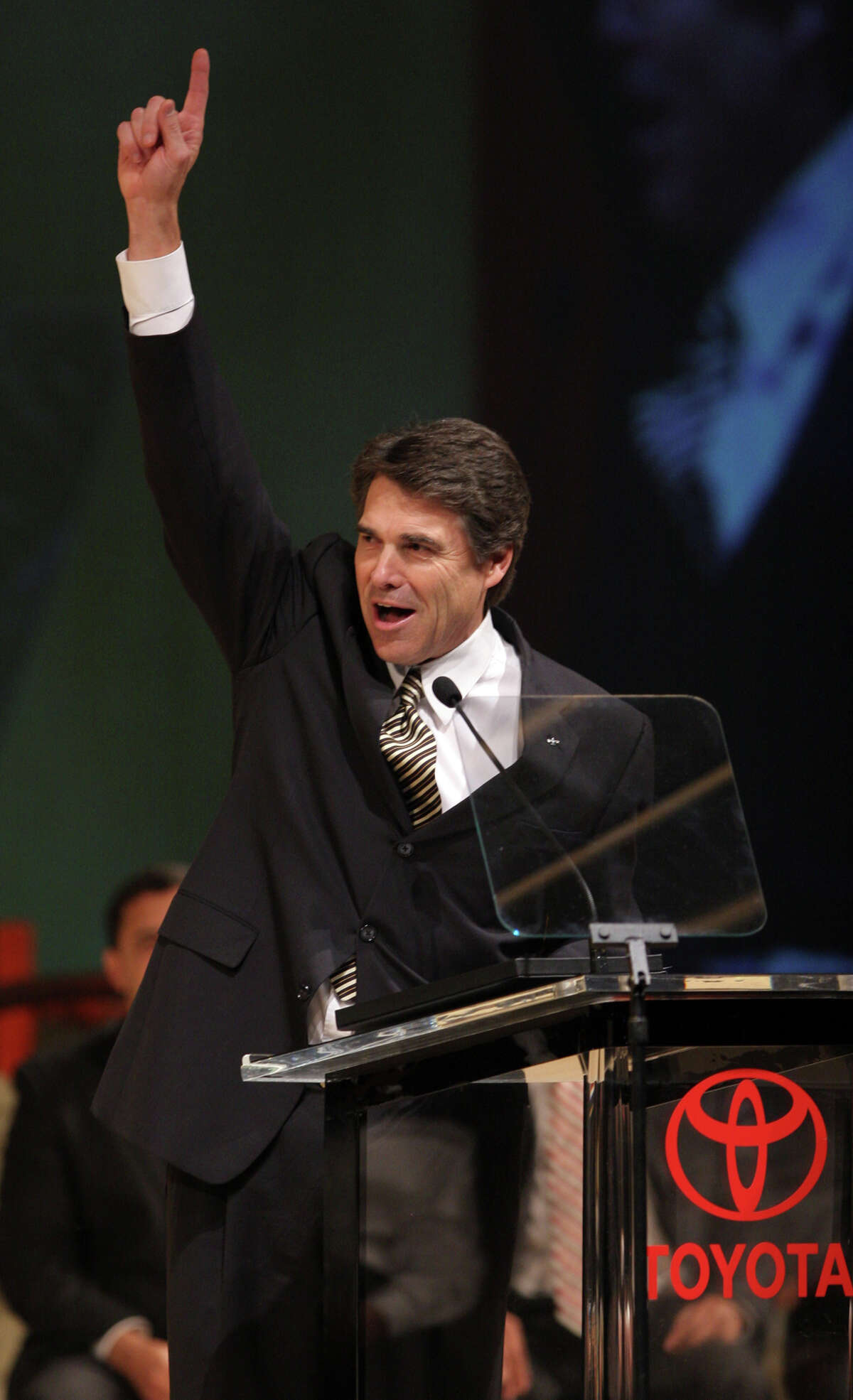 Texas Gov. Rick Perry gives the number one sign as the first Toyota Tundra truck rolls off at the New Toyota Motor Manufacturing of Texas plant in San Antonio, Nov. 17, 2006.