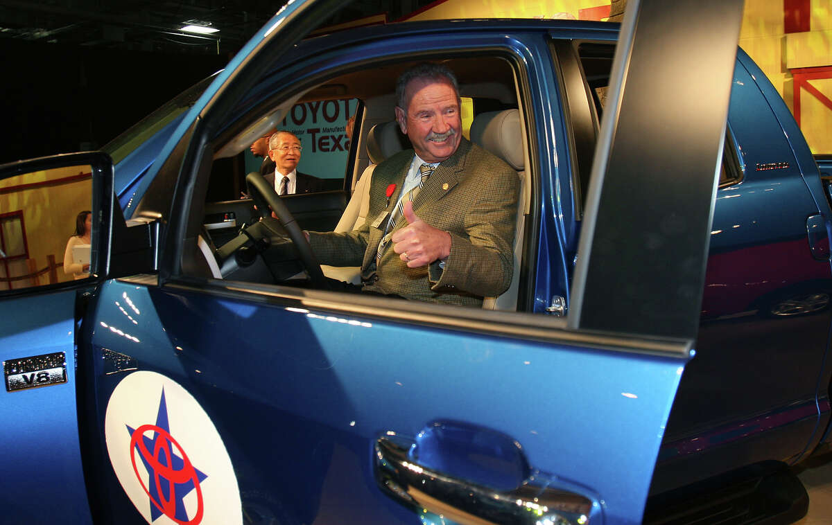 San Antonio Mayor Phil Hardberger gives a thumbs up as he sits in one of the first Toyota Tundra trucks roll off at the New Toyota Motor Manufacturing of Texas plant Nov. 17, 2006.