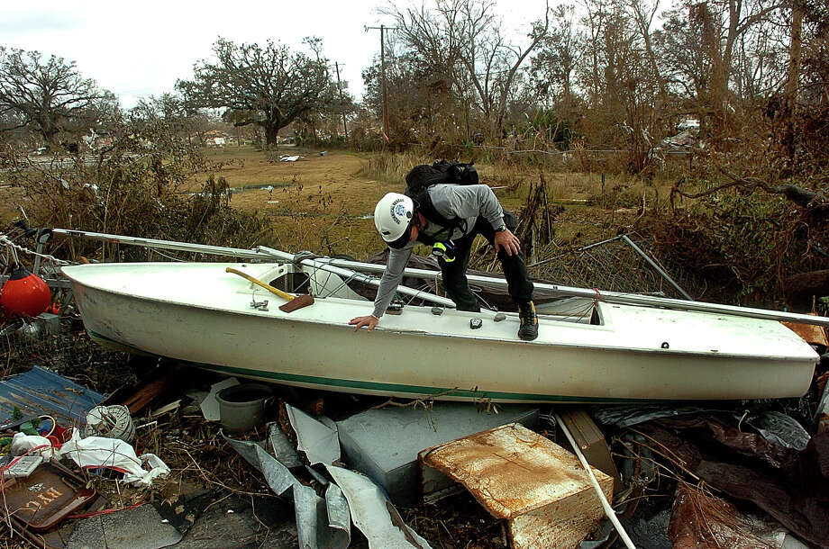 A member of the Florida Taskforce 3, an urban search rescue group out of Central Florida, checks out the inside of a sailboat thrown among the rubble in east Biloxi, Miss. The group was searching the area for anybody still alive and trapped in the rubble. Photo: PATRICK SCHNEIDER, KRT / CHARLOTTE OBSERVER