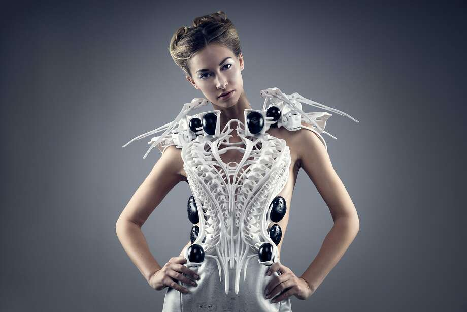 "Dutch fashion designer Anouk Wipprecht is known for mixing technology into her apparel to make clothing that responds to the wearer's vital signs, such as blowing smoke when another person comes too close or making spider-like tentacles flare out to ward off someone intruding into the wearer's space, as seen in this ""Spider Dress,"" now on display, through Sept. 13, 2015, at the Museum of Craft and Design in San Francisco. Photo: Jason Perry"
