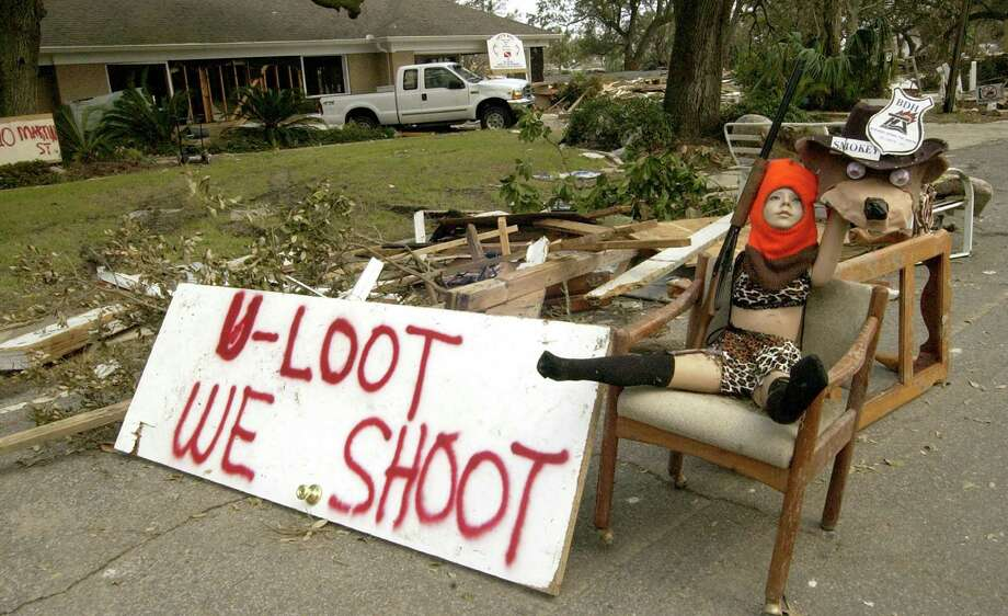 Residents on Martin Street leave a message for looters in Pascagoula, Miss. Photo: CHRISTY PRITCHETT, AP / THE MISSISSIPPI PRESS