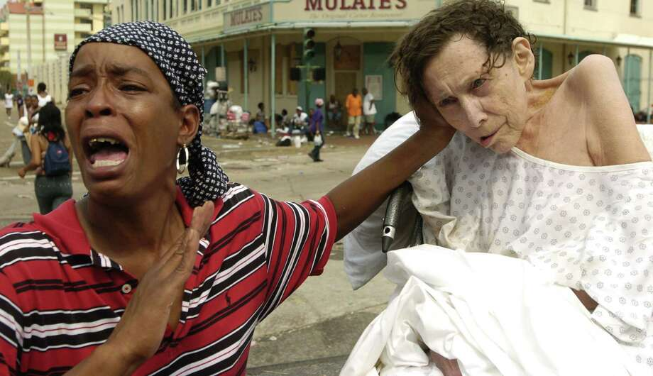 Terri Johnson screams that her in-home care patient is not dead and all she needs is oxygen as she seeks help at the Convention Center in New Orleans during  aftermath of Hurricane Katrina. Photo: MELISSA PHILLIP, © Houston Chronicle / Houston Chronicle