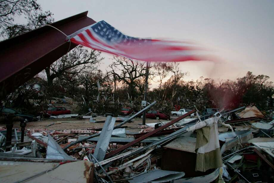 An American flag flies over a pawn shop after it was destroyed by Hurricane Katrina in Biloxi, Miss. Photo: Joe Raedle, Getty Images / Getty Images North America