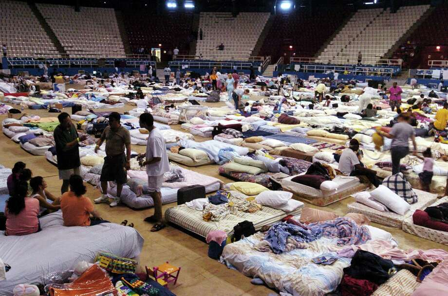 Hurricane Katrina evacuees settle into the shelter at the Hirsch Memorial Coliseum on the Louisiana State Fairgrounds in Shreveport, La. Photo: GREG PEARSON, AP / SHREVEPORT TIMES