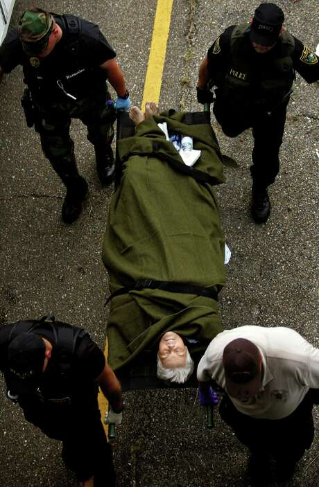 A patient is transported after being evacuated by helicopter to a makeshift transport hub on Interstate 10 in Metairie, La. Photo: KHAMPHA BOUAPHANH, KRT / FORT WORTH STAR-TELEGRAM