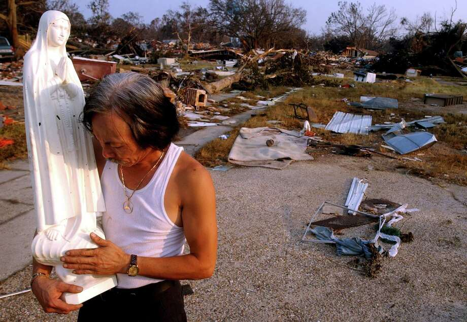 Tam Nguyen holds a statue of the Virgin Mary he recovered from his home in Biloxi, Miss. Photo: EDWARD A. ORNELAS, AP / SAN ANTONIO EXPRESS-NEWS