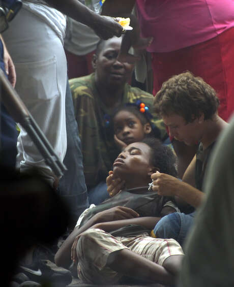 A Hurricane Katrina refugee is tended to outside the Superdome. Shortly after, police carried the woman away and said she had died. Photo: RICHARD ALAN HANNON, AP / THE ADVOCATE