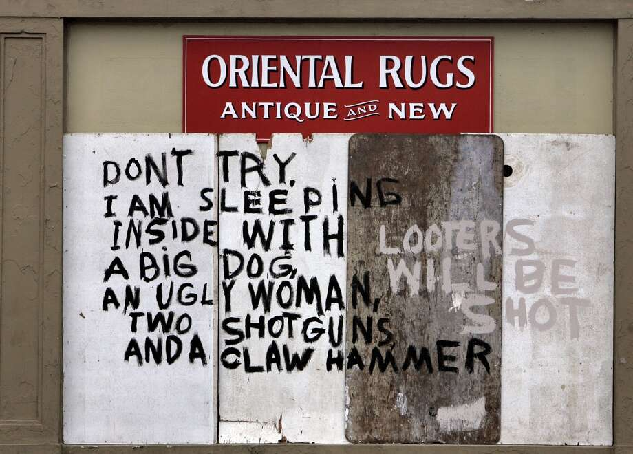 A hand-painted sign outside a New Orleans business warns away looters. Photo: BILL HABER, AP / AP