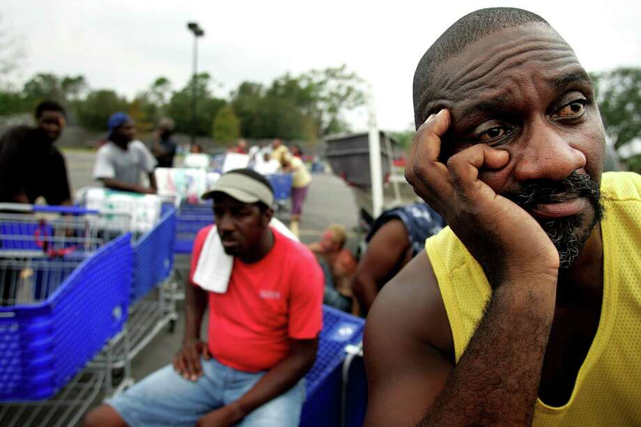 Hurricane Katrina survivor George Reese, from Metairie, bordering New Orleans, waits for supply to be distributed. Photo: KHAMPHA BOUAPHANH, KRT / FORT WORTH STAR-TELEGRAM