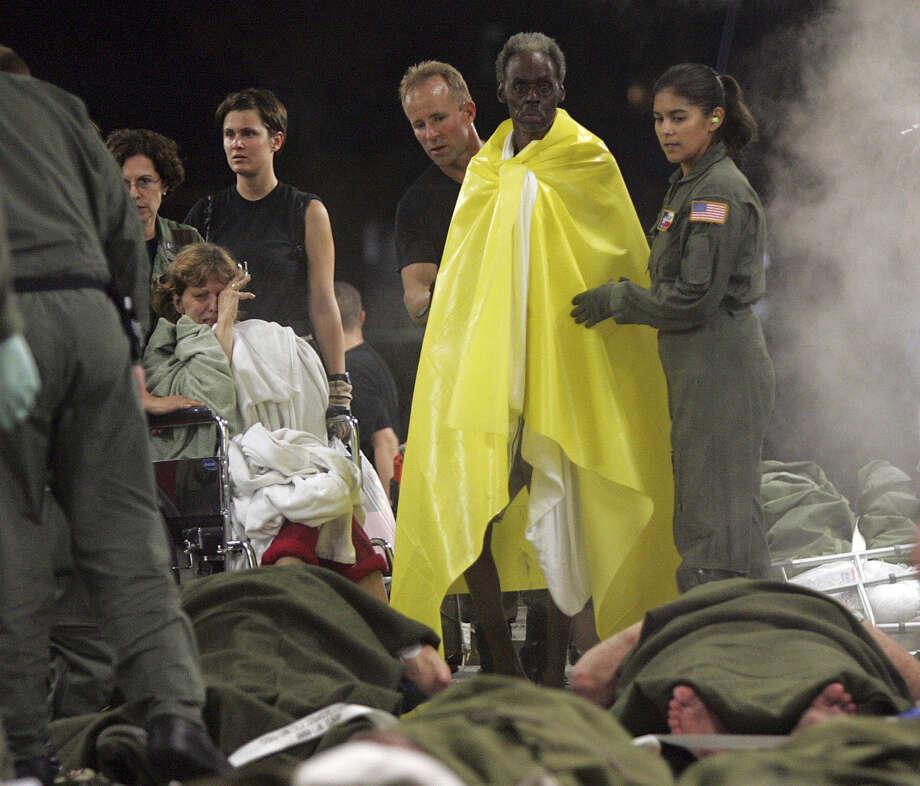 Evacuees are helped to board a C-17 at New Orleans International Airport to seek refuge at Dobbins Air Reserve Base near Atlanta. Photo: KIN MAN HUI, AP / SAN ANTONIO EXPRESS-NEWS