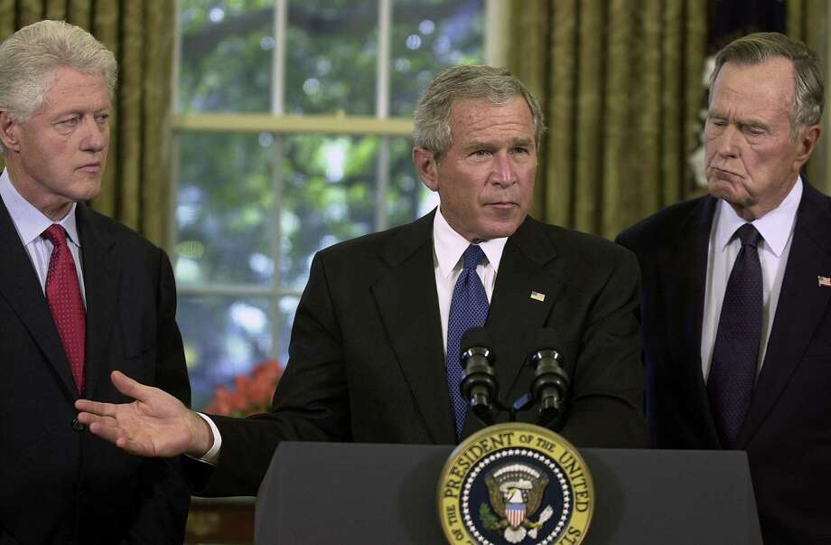 President George W. Bush announces that he appointed former presidents Bill Clinton and George H. W. Bush to lead a fundraising effort for victims of Hurricane Katrina. Photo: Pool, Getty Images / Getty Images Europe