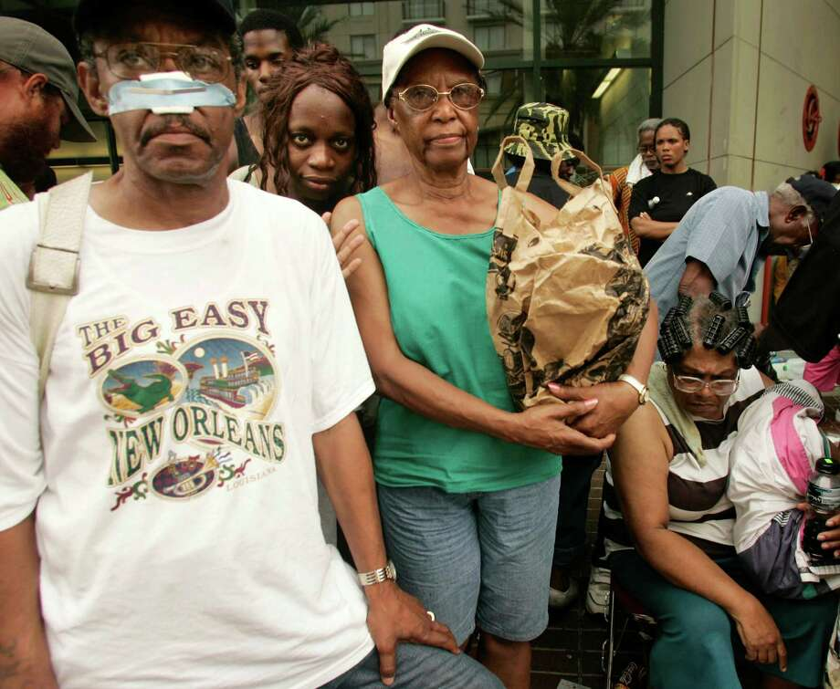 New Orleans evacuees wait in vain for transportation out of the city from its Convention Center. Several people among the thousands of stranded hurricane evacuees have died while waiting outside the building, with no sign of imminent help on the way. Photo: RICK WILKING, Reuters / X00301