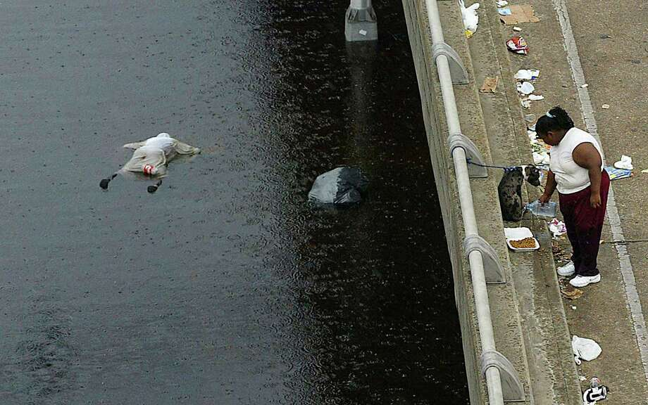 The body of a victim of Hurricane Katrina floats in floodwaters in New Orleans. Photo: JAMES NIELSEN, AFP/Getty Images / AFP
