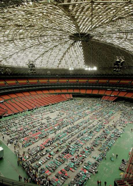 Hurricane Katrina refugees begin to fill up cots on the floor of the Astrodome. Photo: ERICH SCHLEGEL, AP / THE DALLAS MORNING NEWS