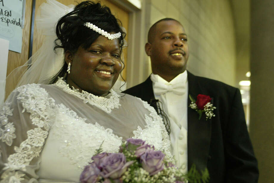 Trenise Williams, left, and Joseph Kirsh smile during their wedding ceremony at a Red Cross shelter Saturday, Sept. 3, 2005, in Jackson, Miss. A week ago, just hours before Hurricane Katrina unleashed catastrophic damage on the Gulf Coast, Williams, 28, and Kirsh, 34, were set to get married at Carrollton Hall in New Orleans. Shelter resident Rochelle Smith heard of Williams' plight on Thursday and decided that a lack of wedding dress or cake wasn't going to stop the couple from having their special day. Photo: CHARLES SMITH, AP / AP