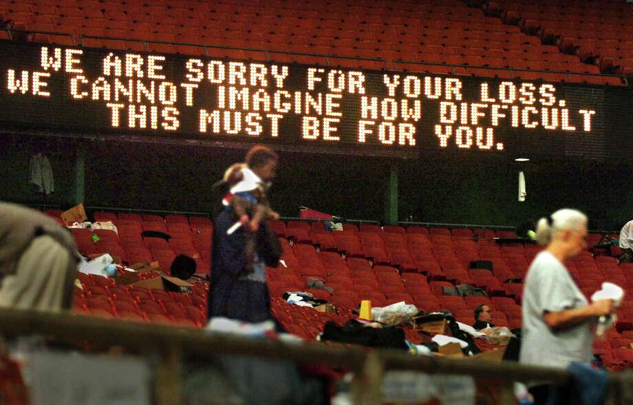 Inside the Astrodome on Sept. 3, 2005: A message to evacuees. Photo: JIM MACMILLAN, KRT / PHILADELPHIA DAILY NEWS