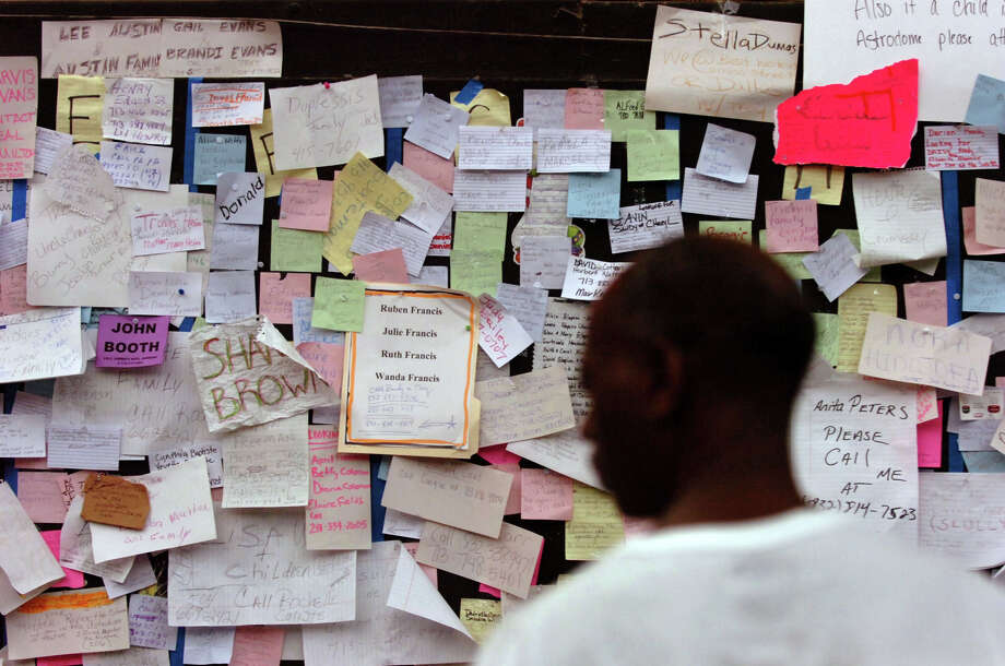Messages left by evacuees in search of missing loved ones are posted inside the Astrodome in Houston, Saturday, September 3, 2005. Photo: JIM MACMILLAN, KRT / PHILADELPHIA DAILY NEWS