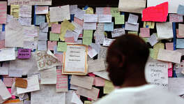 KRT US NEWS STORY SLUGGED: WEA-KATRINA KRT PHOTOGRAPH BY JIM MACMILLAN/PHILADELPHIA DAILY NEWS (September 3) HOUSTON, TX-- Messages left by evacuees in search of missing loved ones are posted inside the Astrodome in Houston, Texas Saturday, September 3, 2005.   (lde) 2005