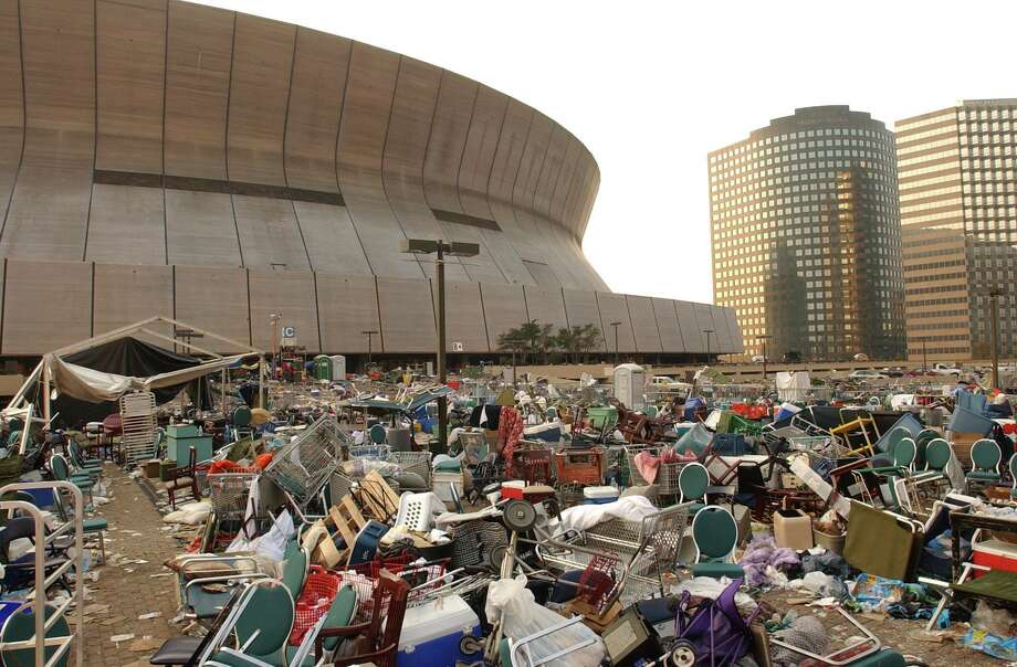 The Louisiana Superdome stands littered and deserted, except for some police, military and an occasional stray dog, Saturday, Sept. 3, 2005, after Hurricane Katrina refugees staying at the Superdome evacuated New Orleans. Photo: GREG PEARSON, AP / THE TIMES