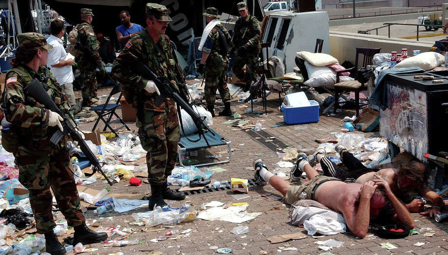 U.S. Army National Guard soldiers watches over two men in downtown New Orleans, Saturday, Sept. 3, 2005. Photo: JESSICA LEIGH, AP / THE (SHREVEPORT) TIMES