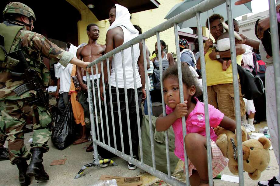 Zakia Sims, 2, waits with scores of others to be evacuated at the Ernest N. Morial Convention Center in downtown New Orleans.  Thousands took refuge at the convention center after Hurricane Katrina devasted the city. Photo: KHAMPHA BOUAPHANH, KRT / FORT WORTH STAR-TELEGRAM