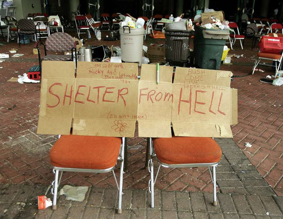 A sign is seen at the Convention Center area in New Orleans, Sept. 3, 2005, after people were evacuated during the aftermath of Hurricane Katrina. Photo: SHANNON STAPLETON, REUTERS / X01249