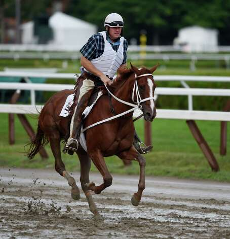 I'm A Chatterbox with trainer Larry Jones in the saddle goes out for her morning exercise on the main track of the Saratoga Race Course Friday morning Aug. 21, 2015.  I'm A Chatterbox will appear next in the Alabama on Saturday.    (Skip Dickstein/Times Union) Photo: SKIP DICKSTEIN