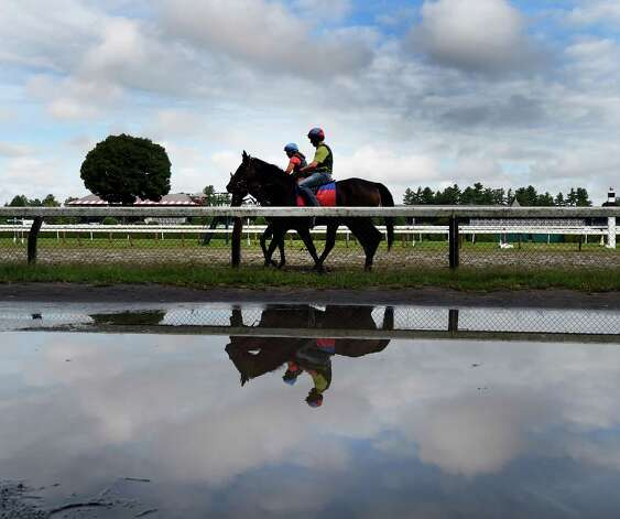 Puddles are seen near the main track of the Saratoga Race Course Friday morning Aug. 21, 2015 after overnight rains dampened the area.    (Skip Dickstein/Times Union) Photo: SKIP DICKSTEIN