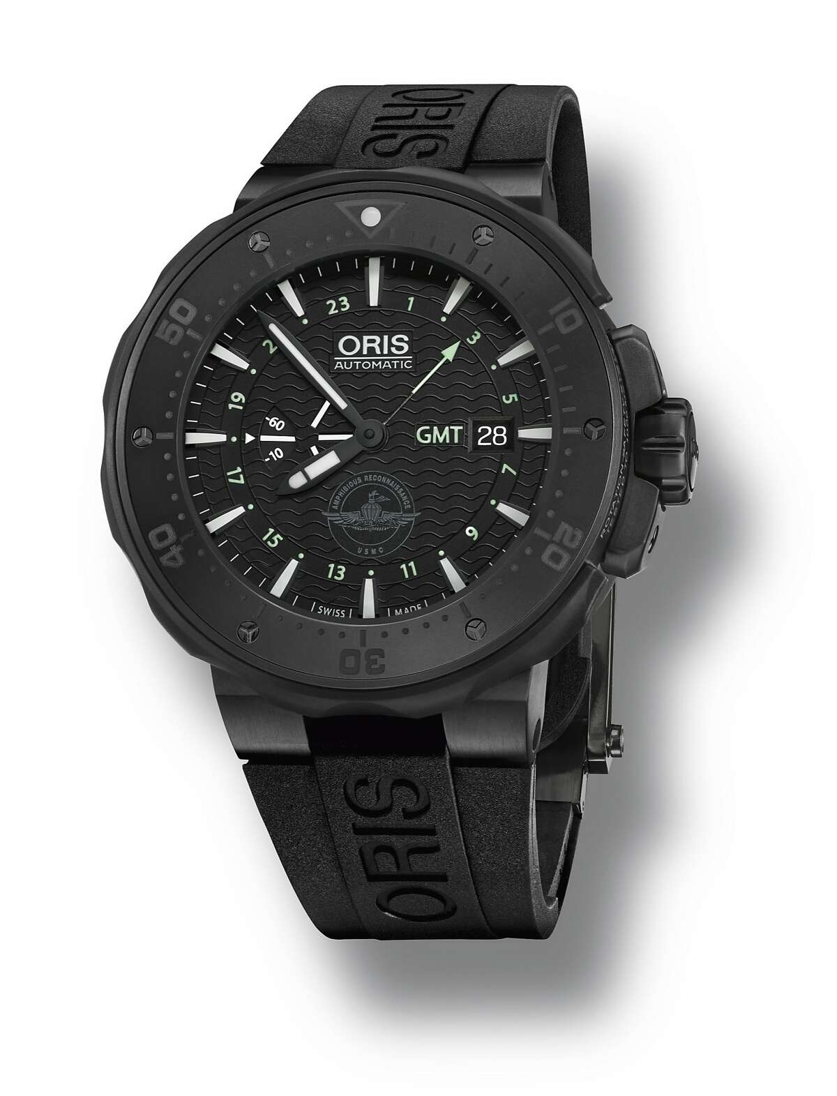 """A new Swiss luxury watch, the Oris Force Recon GMT, has roots in the Bay Area: It was developed by Oris with Menlo Park jeweler Ceci Wong and the 4th Force Reconnaissance Company of the U.S. Marine Corps, located in Alameda. The watch retails for $4,200. It shows a second time zone, was tested during jumping and scuba expeditions, and features a """"small seconds"""" display, designed to show the wearer the watch is working in lowlight conditions, a useful device when """"going dark."""" It comes in a special carrying case with extra straps and tools for minor repairs."""